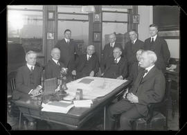 Railroad officials meeting in office at Wells Fargo Building, Portland