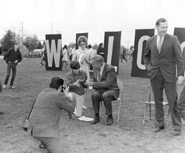 Governor Tom McCall signing autographs at a 1970 Earth Day Celebration