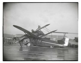 Damaged airplanes in pile at Swan Island after windstorm
