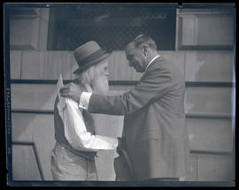 George L. Baker and unidentified man shaking hands at Portland City Hall