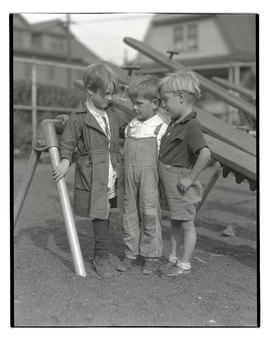 Three unidentified young boys on playground