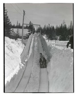 Sledders on Battle Axe Inn toboggan run in Government Camp