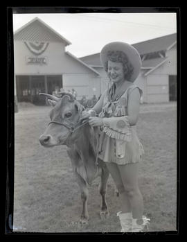 Costumed woman with heifer