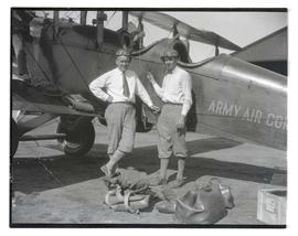 Lieutenant Oakley G. Kelly and Lieutenant William B. Clark with monkey at Pearson Field, Wash.