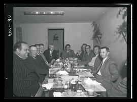 Group of men seated at table