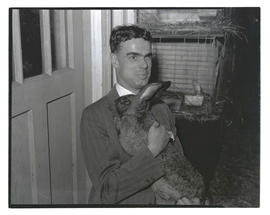 Man holding rabbit