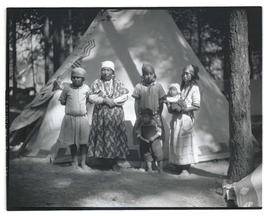 Group of Native American women and children in front of tipi