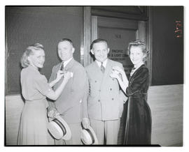 Four unidentified people posing during convention