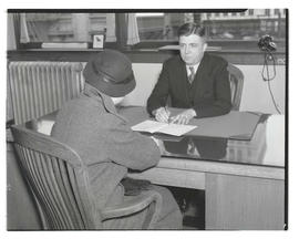 Charles F. Walker? seated at desk with unidentified woman
