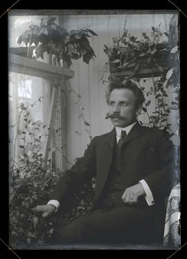 Unidentified man, seated, three-quarters portrait