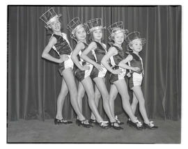 Five young tap dancers posing in a row