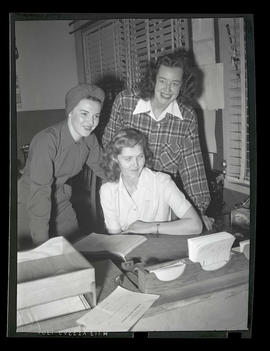 Three employees posing in office, Albina Engine & Machine Works, Portland