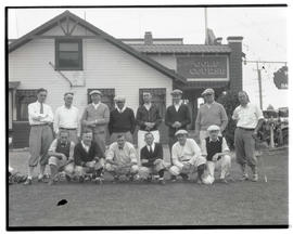 Golfers outside clubhouse at Inverness Golf Course