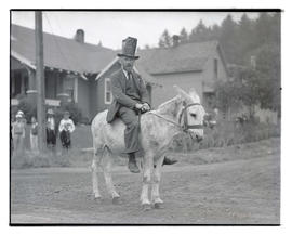 Man riding donkey at parade