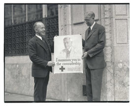A. W. Norblad and unidentified man holding Red Cross poster