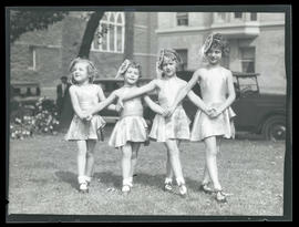 Four young dancers, posing outdoors
