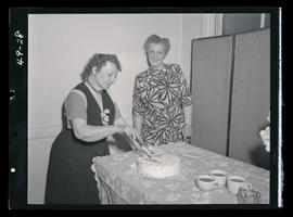 Two unidentified women with cake