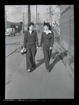 Jeannine Christensen, welder at Albina Engine & Machine Works, walking with unidentified woman