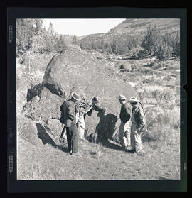 Group looking at petroglyphs at Cove Palisades State Park