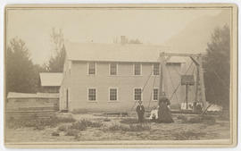 Unidentified woman and two children in front of house, Columbia Gorge, Oregon