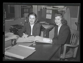 Employees at desk, Albina Engine & Machine Works, Portland
