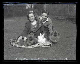 Betty Jane and Wesley Fague Jr. with dogs and rabbit