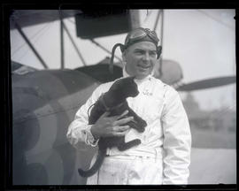 Pilot Tex Rankin holding black cat