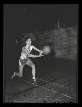 Jack? Butterworth, basketball player for Albina Hellships, passing ball