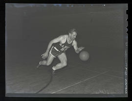 Roy Helser, basketball player for Albina Hellships, dribbling ball