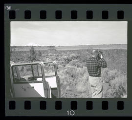 Man with camera at Cove Palisades State Park