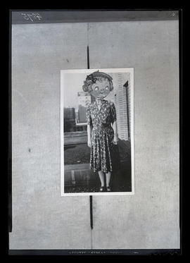 Photograph of unidentified person with cartoon face pasted on top