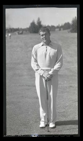 Unidentified golfer holding club