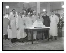 Grand Central Market representatives with anniversary cake
