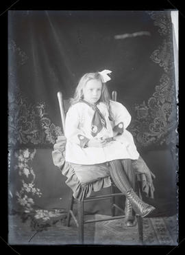 Unidentified girl sitting in chair, full-length portrait