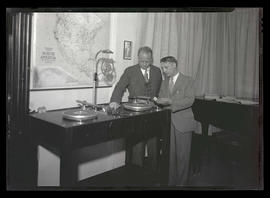 Two unidentified men with KFJR radio equipment