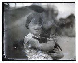 Carol Mangold holding cat she loaned to pilot Tex Rankin