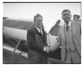 Pilots Frank M. Hawks and Tex Rankin shaking hands at Swan Island airport, Portland