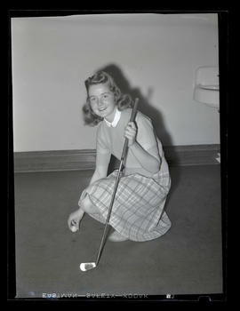 1942 Portland Rose Festival Princess Janis Korlann posing with golf ball and club