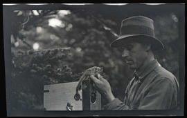 William L. Finley photographing a chipmunk