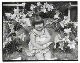 Easter portrait of Joan Adele Ringo holding rabbit