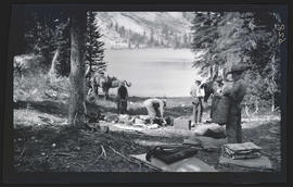 Men packing up camp