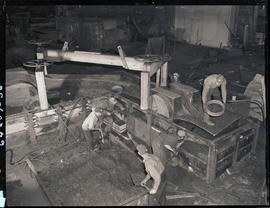 Packing sand into a casting flask at Columbia Steel Casting Company