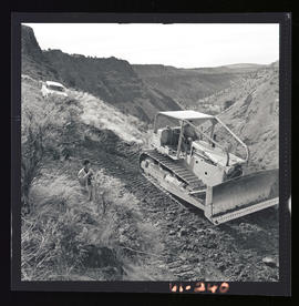 Caterpillar machine working at the Cove Palisades State Park area