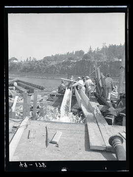 Men working on river dam
