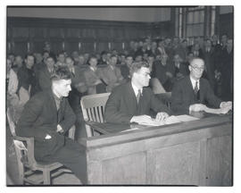 Osbourne, seated in courtroom