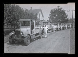 Drivers and delivery trucks at Fulton Park Dairy, Hillsdale, Portland