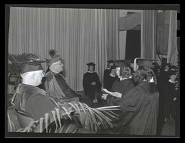 Graduates standing before Archbishop Edward D. Howard at 1943 Marylhurst College commencement