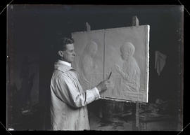 Sculptor with bas-relief of two children