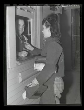 Welder Jeannine Christensen speaking to unidentified man at booth, Albina Engine & Machine Wo...