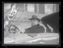 Ely of Hippodrome Theater, seated in car outside central library, Portland